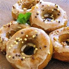 "Maple Pumpkin Doughnuts | ""Baked pumpkin doughnuts are dipped into a maple glaze and finished with some finely chopped pumpkin seeds. What a great way to satisfy your sweet tooth this fall!"""