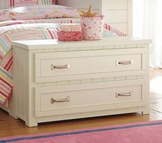 Trunks can be expensive. Take an old dresser, cut the legs down and paint, rough up for the shabby chic look and there you have it.