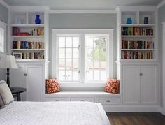 This built-in bench window seat makes for a convenient bedroom reading nook. The bookshelves and storage are a nice touch!