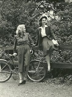 Love this shot from the 1940s featuring 2 looks with high-waisted trousers and 40s hair...gives me a glimpse of what my grandma would have looked like in her twenties.