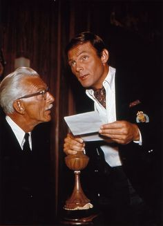 Alfred, the butler, and Bruce Wayne (Adam West) in the Batman TV Show