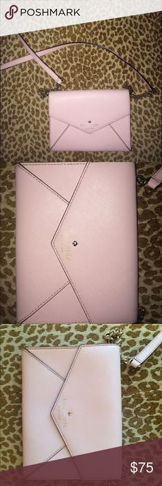 Kate Spade envelope purse Side/crossbody purse. In great condition! Has a couple of marks on the inside but obviously not seen from the outside. It has 3 card compartments on the inside and can fit your phone and small card wallet. I will include the dust bag with a purchase! kate spade Bags Crossbody Bags