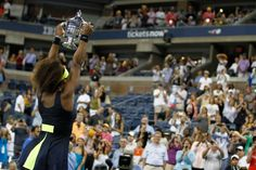 Serena Williams (USA)[4] holds the winner's trophy after defeating Victoria Azarenka (BLR)[1] in the final of the 2012 US Open. - Philip Hall/USTA