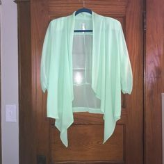 Mint green light jacket Mint green light green jacket? Blazer? Type top. Made of  100% Polyester. Size 2x. Offers only accepted through offer button. Tops