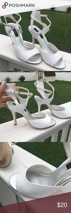 White House Black Market White Heels Strappy design at the ankles. Supportive at the ankles, adjustable straps. Small imperfection in the inside of one shoe (reflected in the price)  Bundle with other items in my closet for a great discount!! White House Black Market Shoes Heels
