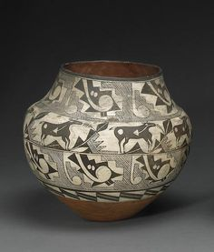 An Acoma jarProperty from the Estate of Elaine Horwitch, Scottsdale, AZ An Acoma jar Painted with three busy geometric panels enclosing a central row of Zuni-style heartline deer. Native American Genocide, Native American Wisdom, Native American Indians, Native Indian, Native Americans, Native American Baskets, Native American Pottery, Decorated Flower Pots, Pueblo Pottery