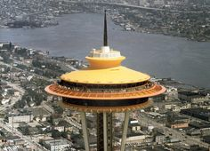 """Aerial view of the Space Needle and surrounding area in Seattle in 1962. The Century 21 Exposition, also called the Seattle World's Fair, was held from April 21, 1962, to October 21, 1962. This year, to celebrate the 50th anniversary, the iconic Space Needle was once again painted in its original """"Galaxy Gold"""". (AP Photo)"""