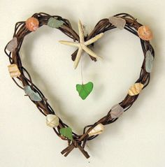Hand crafted driftwood wreath with sea glass, barnacles, natural sea shells and sand dollars found along the coast of Maine. Description from pinterest.com. I searched for this on bing.com/images