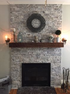 Silver Travertine stacked stone and reclaimed wood mantel ! renovated old chimney that was in bad shape. This turned out gorgeous!