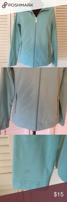 Light Jacket in aqua color Pre-loved.  Zips,  Two pockets that zip down.  A small stain on sleeve as seen in last photo.  Wouldn't normally list,  but other than that it's an awesome comfortable Jacket and great Brand.  Price reflects stain. croft & barrow Jackets & Coats