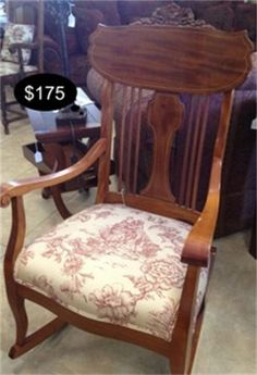 Darling toile upholstery in a soft burgundy and detailed back accent this gorgeous rocking chair. And for only this price??  Yesterdays Treasures Consignment  5829 Lone Tree Way Suite J  Antioch  925 - 233 - 4547  www.Yesterdayststore.com  Info@yesterdayststore.com