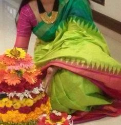 Parrot green Ikkat saree with temple border. Indian fashion. Traditional silk sari with blouse.