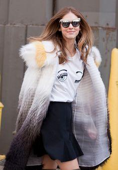 Chiara Ferragni wearing an ombré fur coat, mirrored cat-eye glasses, + a 'winking eye' graphic t-shirt