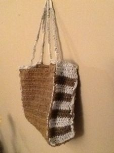Crochet beach bag made with plarn (plastic yarn). Free Instructions included