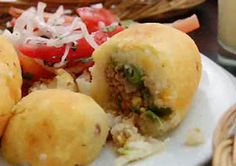 Papa Rellena is a croquette filled with spicy beef, onions and tomatoes, and wrapped in mashed potatoes that are formed around the mixture. Peruvian Cuisine, Peruvian Recipes, Bolivian Food, Bolivian Recipes, Colombian Cuisine, Colombian Recipes, Comida Latina, Cooking Recipes, Healthy Recipes