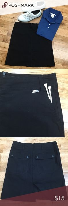 "Casall Black Athletic Skort Black athletic skort by Casall. This skort features deep side pockets and belt loops. There are two back pockets with snap closures and 5"" slit at the hem for ease of movement. Hidden back zipper. 62% cotton, 33% polyamide & 5% elastane - machine wash/air dry per tag. Casall Shorts Skorts"