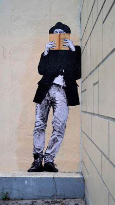 "Street Artist: Levalet Or maybe an outline of this with a caption saying ""read"""