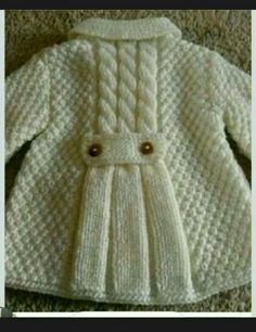 Love the top three cables turning into plain knit from little back belt strap downwards resembling pleats. Baby Cardigan Knitting Pattern Free, Baby Boy Knitting Patterns, Knitting For Kids, Knitting Designs, Baby Patterns, Kids Outfits, Baby Outfits, Knit Baby Sweaters, Baby Coat