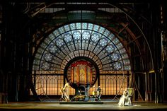 The Tales of Hoffman. Lyric Opera in Chicago, Illinois. Design by Ezio Frigerio. This design has two main design elements line and shape. The use of these two elements make a force perspective to the center of the stage. The circles start out large and progressively grow smaller. The lines all point towards the inner circle. There are also some really cool elements including the flower shapes, the organ pipes in the middle, and that the light can shine through the back of the whole set.