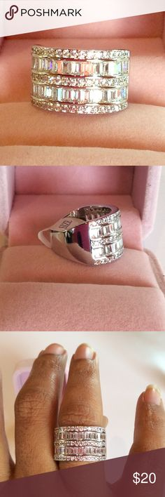 Restocked 🆕925 Stamped  Cubic Zirconia  Ring Sterling silver and cubic zirconia make up this fabulously extravagant looking statement ring. You will receive rave reviews. Pictures do not do this ring justice. Pink ring box is a prop only and will not come with the ring when purchased. Jewelry Rings