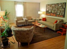 mid century modern living room with orange accents