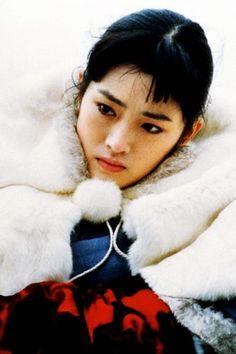 Gong Li in Raise the Red Lantern directed by  Zhang Yimou in 1991