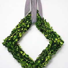 Check this out: DIY Boxwood Diamond Wreath. https://re.dwnld.me/qxVj-diy-boxwood-diamond-wreath
