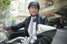 Portrait confident businessman commuting on motorcycle by Hero Images  on 500px