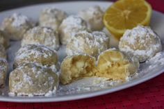 Lemon Melt in Your Mouth Cookies by Deals to Meals--so yummy, small, cute & perfect for a spring time brunch or snack. It's a mix between a wedding cookie, lemon bar and a chocolate chip cookie. Super delicioso!