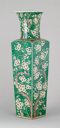 "FAMILLE VERTE PORCELAIN VASE Kangxi Period   In rectangular form with prunus decoration on a green ground. Passionflower design at shoulder. Six-character Kangxi mark on base. Height 22 3/4"" (57.5 cm)."