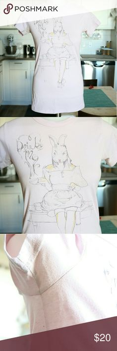 Alice in Wonderland 'Drink Me' Conceptual Art Tee Alice in Wonderland light pink tee, of Alice as the white Rabbit and her tea cup with 'Drink Me' steam coming up. Bought in Disney Land. Fabric: 50% Cotton 50% Polyester Junk Food Tops Tees - Short Sleeve