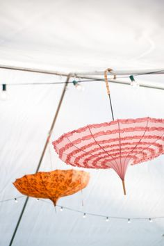 It's perfectly fine shopping excuse to collect awesome vintage umbrellas to decorate your wedding tent!