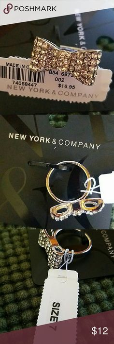 NWT BOW RING SIZE 7 NEW YORK & COMPANY Brand new size 7 cute bow ring. Silver colored.  Cute bling! Bundle up and save. Happy poshing! New York & Company Jewelry Rings