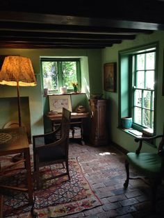 Old English cottage with brick floor. The sitting room at Monk's House, home of Virginia Woolf.
