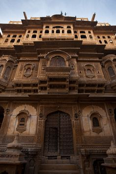 The front facade of the Nathmal-Ki-Haveli home.    Haveli are Islam-inspired homes used in India to refer, most often, to mansions owned at one time by wealthy merchants. This particular haveli, located in central Jaisalmer, is a great example of the intricate facades of haveli design.