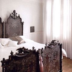 stunning cama portuguesa / portuguese bed. Delicate, spidery, details make this rich, ornate frame feel less grandly impersonal and more like a live-able heirloom.