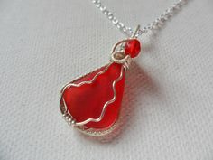 "Red sea glass necklace - Sterling silver 18"" chain and red swarovski crystal wire wrapping by ShePaintsSeaglass on Etsy"
