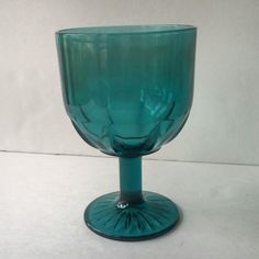 A teal blue planter that can also be used as a candle holder.  Add some water and a floating candle and you have a lovely wedding table centerpiece. #diy #homedecor #weddingideas