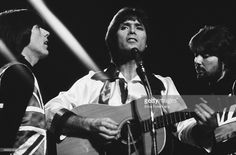 Cliff Richard performs on stage at the Royal Albert Hall,London, December 1976. (Photo by Erica Echenberg/Redferns)