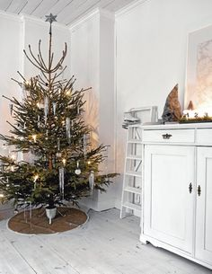 """i love the simplicity and imperfections of this tree... and how the tree stand is so nice looking. I also love the """"tree skirt"""""""