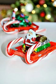 How to Make Candy Sleighs - About A Mom - It is easy to be tempted by sweets during the holidays season. Learn how to make a fun candy sleigh and get tips from the National Candy Association for how to enjoy candy in moderation this holiday season. Christmas Candy Crafts, Candy Cane Crafts, Christmas Gifts For Mom, Homemade Christmas Gifts, Christmas Projects, Holiday Crafts, Christmas Decorations, Christmas Sleighs, Christmas Ideas