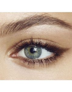 natural look of eye makeup, with defined eyeliner and blended brown eyeshadow