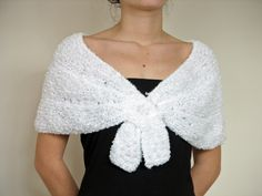 Soft and white touch, knitting bridal capelet in white. $45.00, via Etsy.