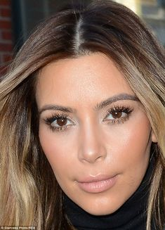 Not a line in sight: At the age of 33, Kim is completely void of any wrinkles