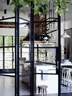 Hellooo, you gorgeous industrial kitchen, Those windows! Or are they doors? Either way, we're in love. #kathykuohome