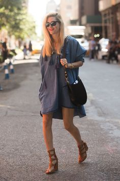 Joanna Hillman beat the heat in a little denim dress from H&M and a pair of gladiator sandals.