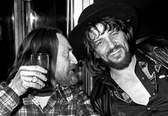 Willie Nelson and Waylon Jennings enjoy a drink together in New York in 1978.
