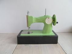 A green Soviet kids toy sewing machine. The machine is in working order and comes with an original needle. This wonderful vintage sewing machine has