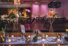 Wedding Reception | Pink Lighting | Neon Sign | Gold Geometric Candlesticks | Orange Lily | Pink Protea | Infinity Candles | Table Runner | Hanging Greenery | Walnut Tables | Photo Credit - EpagaFOTO