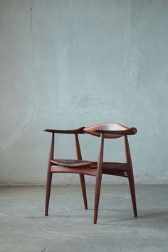 Hans J. Wegner (1914 - 2007) C34 armchair in wood and leather Denmark, 1950's H 70 cm x W 60 cm x D 46 cm Designed for Carl Hansen & Søn, Odense